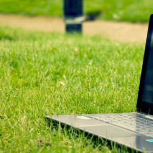 Image of laptop sitting in the grass